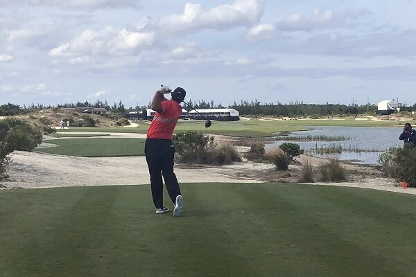 Patrick Reed watches his tee shot