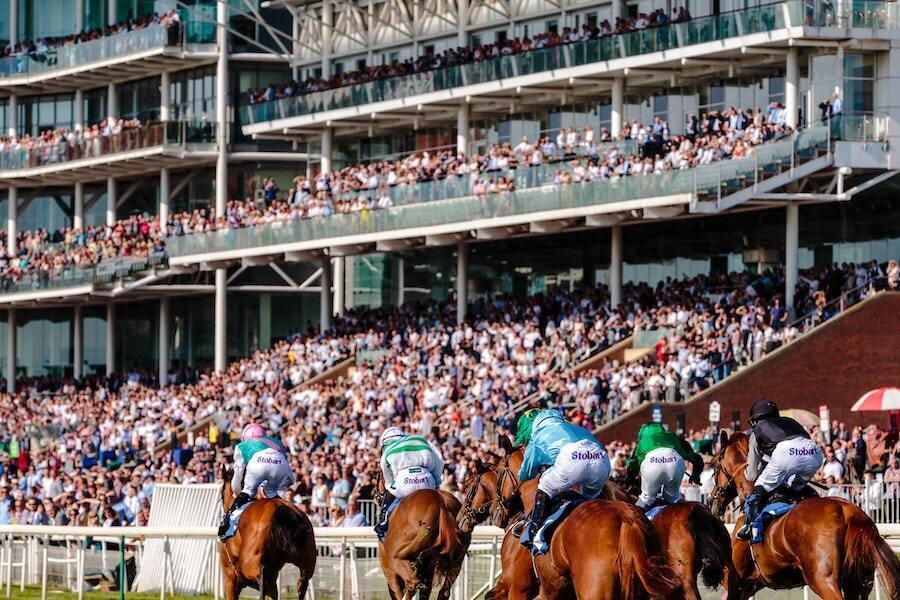 jockeys on horses at kentucky derby at churchill downs