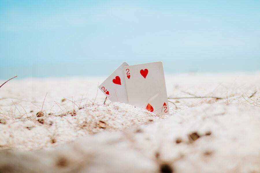 2 of hearts playing cards in the sand