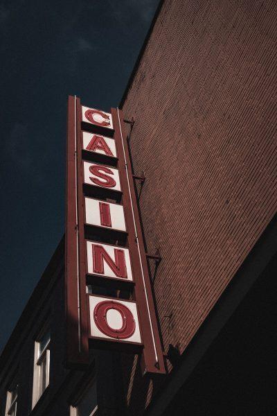 vertical light up casino sign at night