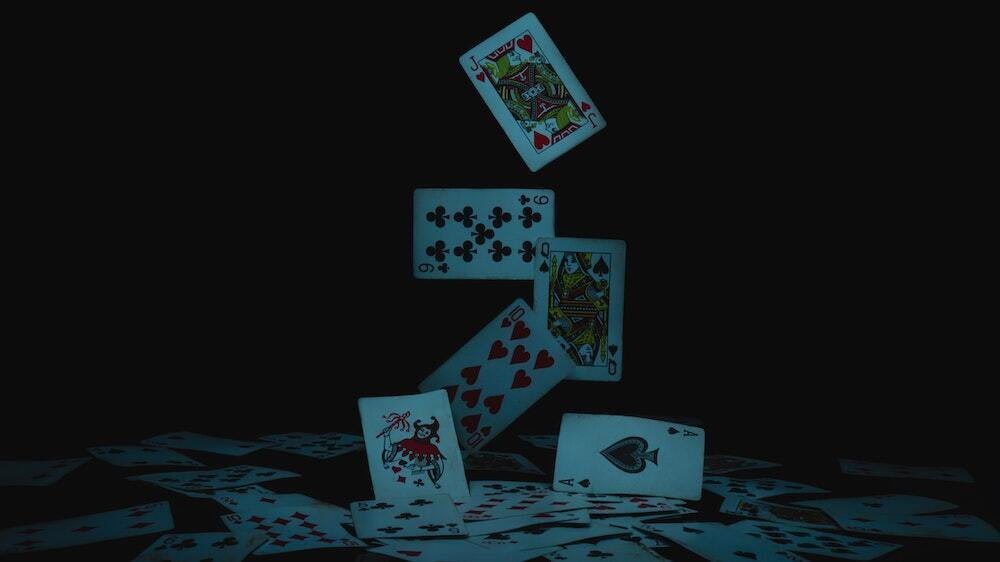 playing cards falling through the air falling on table